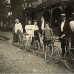 View of a group of bicyclists standing with their bicycles in front of the residence of Atlanta contractor William Bensel at 66 East Ellis Street, between Ivy Street and Courtland Street in Atlanta, Georgia, 1897.