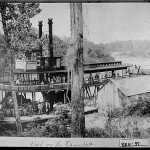 "Hawkinsville, 1897. The steamboat, the ""City of Hawkinsville,"" prepares to leave for its maiden trip transporting bales of cotton on the Ocmulgee River."
