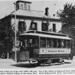 A Van Depoele system car of the early 1890's rolls past Atlanta's Southern Medical College on the Inman Park line of the Atlanta and Edgewood Street Railroad.