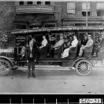 Photograph of open passenger bus in front of J. William Lee, Undertaker & Livery, Georgia, ca. 1914-1915