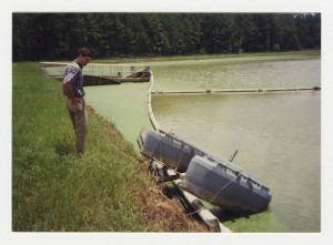 Photograph of Contractor Accessing Flood Damage at Wastewater Treatment Pond, Byron, Peach County, Georgia, 1994 July 8