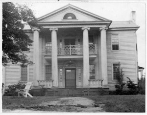 A black and white photograph of the Old Corley House located in Covington, Georgia.