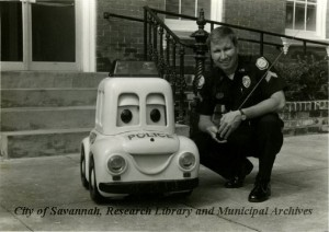 Cpl. K.R. Porter with RC Robot Patrol Car. City of Savannah, Public Information Office. Courtesy of City of Savannah, Research Library & Municipal Archives.