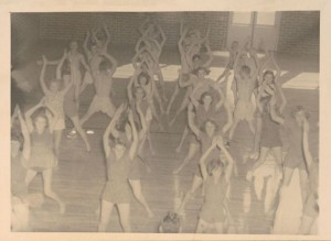 Photograph of high school girls performing calisthenics in a physical education class at Screven County High School, Sylvania, Georgia, 1951. Screven-Jenkins Regional Library System Collection, Screven-Jenkins Regional Library System.